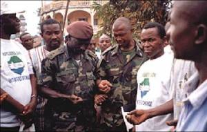 Representatives of the Sierra Leone Military Brigade in Makeni lead Christian and Muslim prayers after a reconciliation